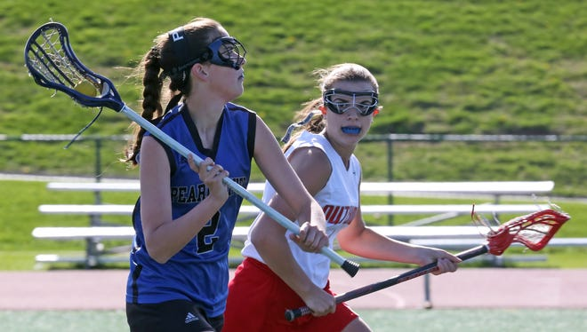 Tappan Zee's Leanna Lobbi (9) tries to steal the ball away from Pearl River's Aileen McBride (2) during girls lacrosse game at Tappan Zee High School April 28, 2015. Pearl River defeats Tappan Zee 10-9.