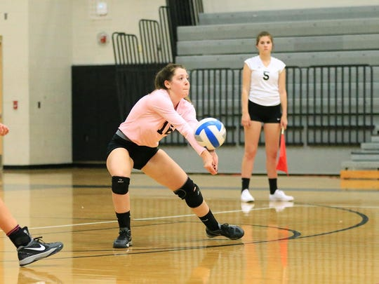 Plymouth senior libero Charley Irvin launches the ball back over the net Wednesday night.