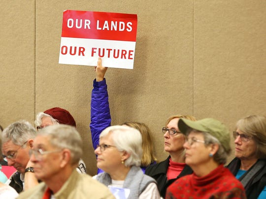 "Protesters with the ""keep it in the ground"" movement attend a Bureau of Land Management oil and gas lease auction in Salt Lake City on Feb. 16, 2016."