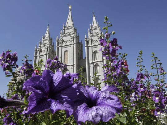 Flowers bloom in front of the Salt Lake Temple in Salt Lake City.