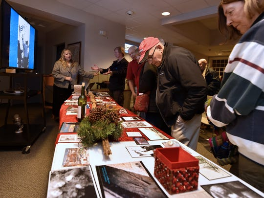 Audience members were invited to look over some of the artifacts that were recovered years ago from the Christmas Tree Ship which sank off Two Rivers in 1912. Award-winning author Rochelle Pennington, left, kicked off the Door County Maritime Museum's Maritime Speakers Series on Thursday.
