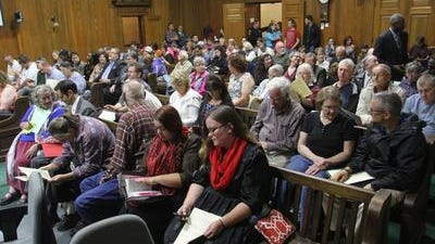 File photoCity Council chambers are packed at a past meeting in which the sexual orientation and gender identity ordinance was on the agenda. Council members recently discussed changing speaker time limits for such meetings.