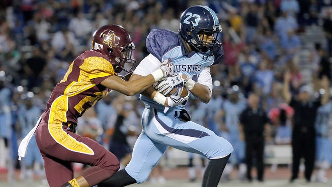 Andress defensive back Bryan Haynes tries to strip the ball from Chapin receiver Michael Denton's hands after a long reception Friday.
