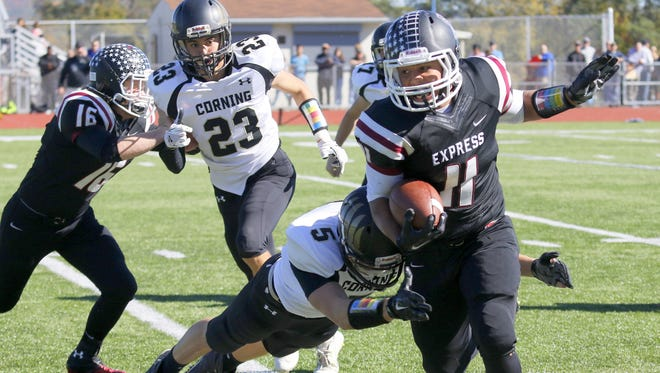 Corning's Danny Madden dives to tackle Elmira's Dashaun Sutton during Saturday's Section 4 game at Marty Harrigan Field.