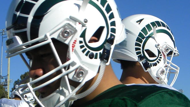 The CSU football team wore new green-horn, white helmets at practice in Albuquerque on Wednesday in advance of Saturday's New Mexico Bowl.
