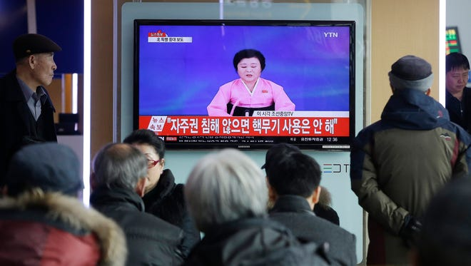 "People watch a TV news program showing North Korea's announcement, at the Seoul Railway Station in Seoul, South Korea, Wednesday, Jan. 6, 2016. North Korea said Wednesday it had conducted a hydrogen bomb test, a defiant and surprising move that, if confirmed, would put Pyongyang a big step closer toward improving its still-limited nuclear arsenal. The letters read "" Will not use nuclear weapon if autonomy secured.""  (AP Photo/Ahn Young-joon)"