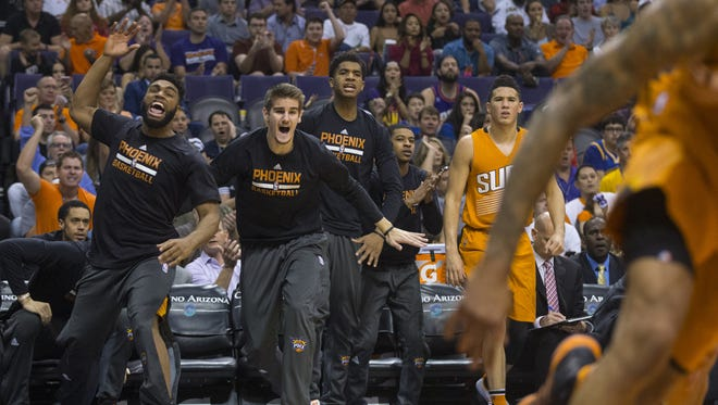 The suns bench reacts after an alley-oop against the Warriors at Talking Stick Resort Arena on October 30, 2016 in Phoenix, Ariz.