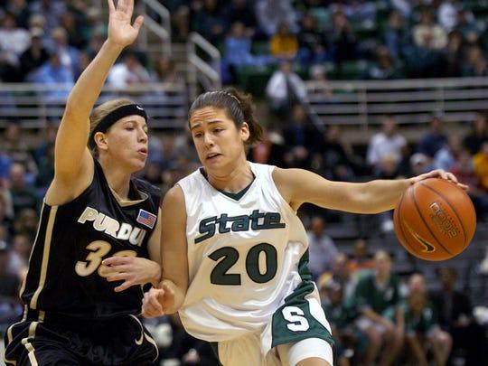 MSU's Lindsay Bowen, right, drives around Purdue defender Erika Valek, left, en route to a score Thursday night.