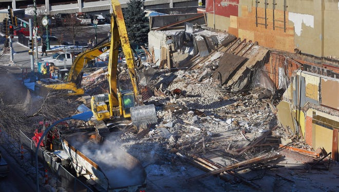 Crews continue to cleanup debris from the old Copper Lounge and Skelly's buildings in downtown Sioux Falls on Tuesday, Dec. 13, 2016, after it collapsed killing one and injuring another.