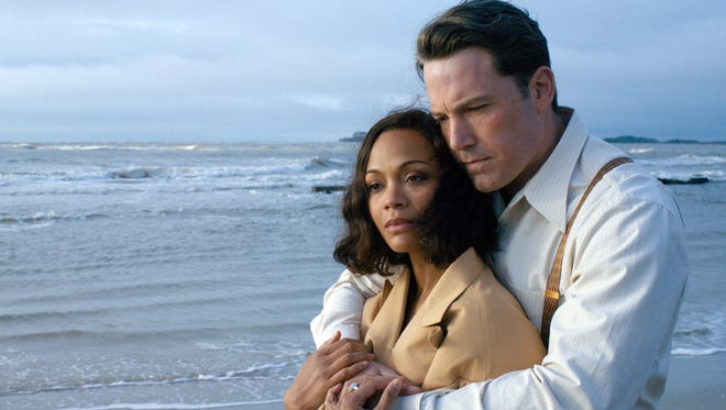 "This image released by Warner Bros. Entertainment shows Zoe Saldana, left, and Ben Affleck in a scene from ""Live By Night."""