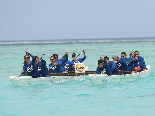 The IT&E Guam team push for a victory during the 9th annual 76 Paddles Against Cancer event at Matapang Beach in Tumon on March 25, 2018.
