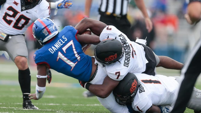 Kansas quarterback Jalon Daniels is sacked during the first half of last Saturday's 47-7 defeat to then-No. 17 Oklahoma State at David Booth Kansas Memorial Stadium in Lawrence. Daniels, a true freshman, left in the second quarter with an apparent foot injury.