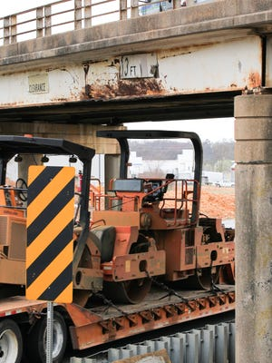 A truck carrying construction equipment drives under a bridge over U.S. 29 on Tuesday, outside Williamston in Anderson County. The bridge has a sign showing a 13 foot clearance.