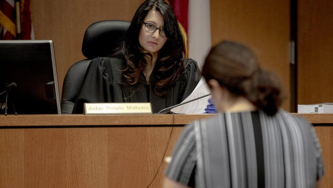 Court-at-Law Judge Dimple Malhotra listens to a request for protective orders on March 27 in Austin.