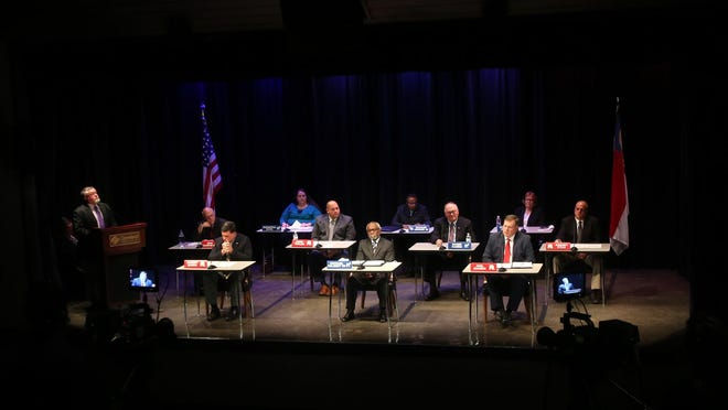 The 10 candidates up for Cleveland County Board of Education answer questions at a forum on Tuesday.