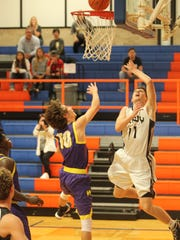 Brady High School's Will Hollis (right) puts up a shot against Merkel during a Class 3A Region I bidistrict basketball playoff at Central High School's Babe Didrikson Gym on Tuesday, Feb. 20, 2018. Merkel won 51-44.