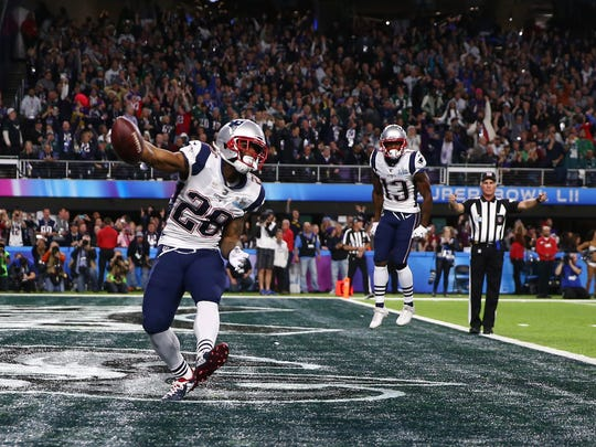 New England Patriots running back James White (28) celebrates after scoring a touchdown against the Philadelphia Eagles in the second quarter in Super Bowl LII at U.S. Bank Stadium.
