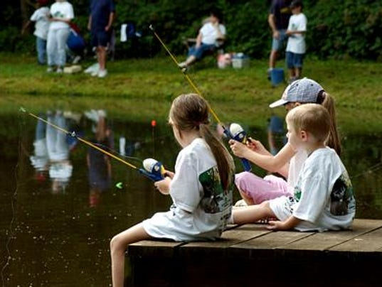 Children wait on a bite during last year's Fishing Rodeo. Bob Ealum special to the Advertiser.