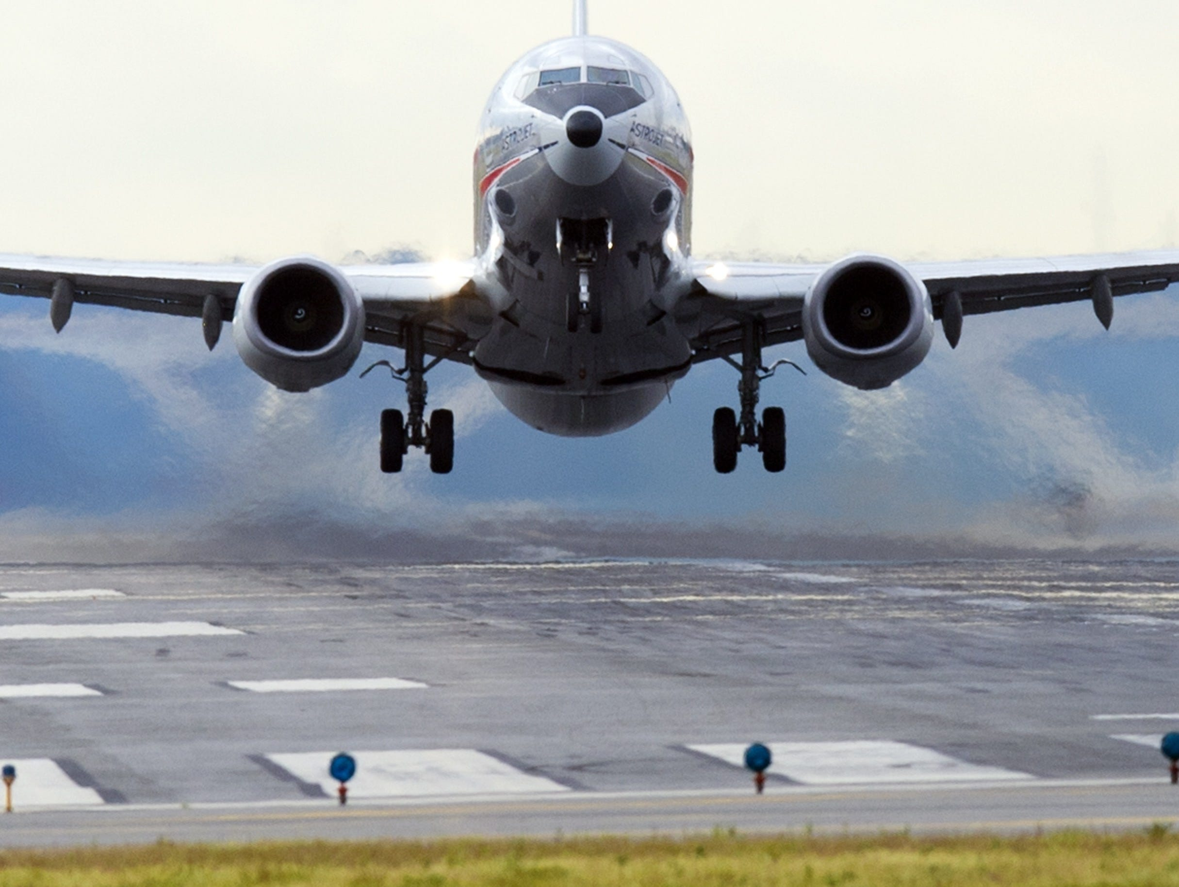 This file photo shows an American Airlines Boeing 737 airplane as it takes off from a runway at Ronald Reagan Washington National Airport in Arlington, Va.