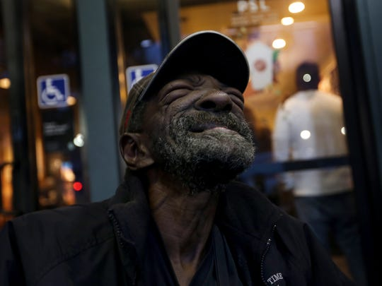 "In pain, Eddie ""Snake"" Carter, a wheelchair-bound double amputee, sits outside Starbucks in Hollywood, Calif. (Francine Orr/Los Angeles Times/TNS)"