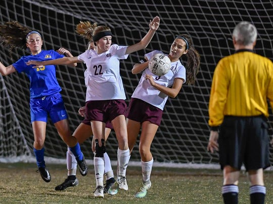 Henderson's Caitlyn Honeycutt (22) and Marissa Sauer (3) deflect a corner kick in front of the Colonel goal as Henderson County plays Caldwell County in the Girls 2nd Region final played at Madisonville North Hopkins High School in Hanson Thursday, October 19, 2017.