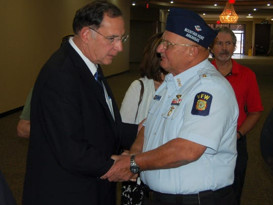 U.S. Senator John Boozman (left) talks wih veteran Larry Krause Thursday after the ribbon cutting ceremony for the Mountain Home Community Based Outpatient Clinic. Kruase served in the Armed Forces for 24, serving in both the Navy and the Army.