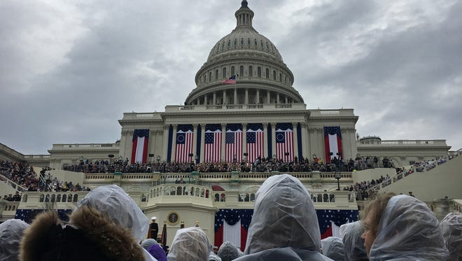 Come rain or shine, crowds gathered at Donald Trump's presidential inauguration in Washington on Friday.