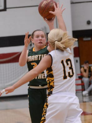Martin Luther's Grace Amling elevates for a shot over