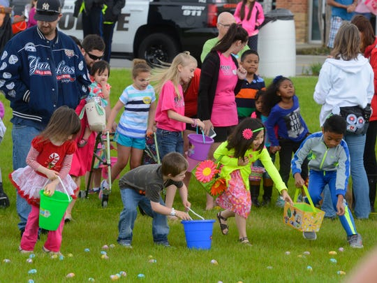 Kids race around snatching up Easter eggs during a previous Egga-Wahooza Easter Egg Hunt at Community Maritime Park. This year's event is set for Saturday.