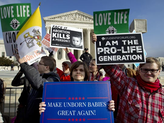 Anti-abortion activists protest outside of the U.S. Supreme Court, during the Jan. 18 March for Life in Washington. Anti-abortion lawmakers and activists in numerous states are pushing near-total bans on the procedure in a deliberate frontal attack on Roe v. Wade.