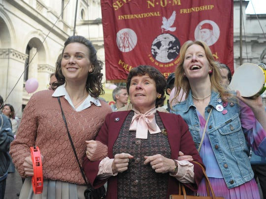 "Liz White, Imelda Staunton and Nia Gwynee in a scene from the film ""Pride."""