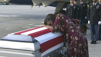 "Myeshia Johnson cries over the casket of her husband, Sgt. La David Johnson. WPLG via AP ADDS TRUMP'S RESPONSE TO REP. WILSON - In this Tuesday, Oct. 17, 2017, frame from video, Myeshia Johnson cries over the casket of her husband, Sgt. La David Johnson, who was killed in an ambush in Niger, upon his body's arrival in Miami. President Donald Trump told the widow that her husband ""knew what he signed up for,"" according to Rep. Frederica Wilson, who said she heard part of the conversation on speakerphone. In a Wednesday morning tweet, Trump said Wilson's description of the call was ""fabricated."" (WPLG via AP)"