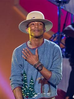 """In this file photo, Pharrell Williams performs onstage during, """"A Very Grammy Christmas,"""" at The Shrine Auditorium in Los Angeles. The Recording Academy will announce the nominees for the 57th annual Grammy Awards today. Williams submitted a live version of the song, so he has a chance of earning nominations for record of the year and best pop solo performance."""