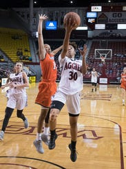 Aggies Gia Pack finishes the fast break with pressure