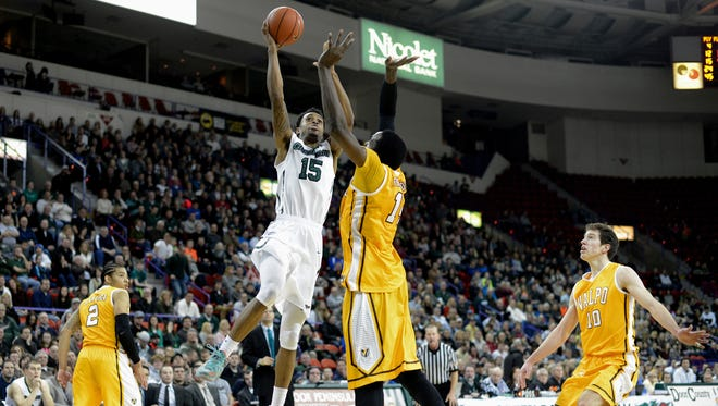 UW-Green Bay forward Greg Mays takes a shot in front of Valpariso center Vashil Fernandez in the second half. UW-Green Bay defeated Valparaiso 51-50 at the Resch Center in Ashwaubenon, Wis. on Friday, Jan. 23, 2015. UW-Green Bay defeated Valparaiso 51-50.