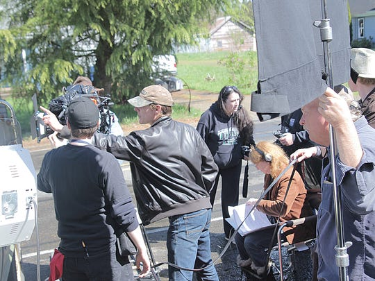 """Phillip Wade (center) leads a group on the set of """"Chryzinium."""""""