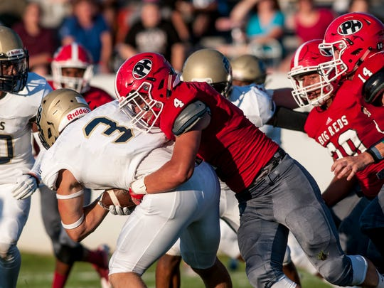 Port Huron senior Clay Carter tackles Detroit Country Day senior Nick Neibauer during a football game Friday, August 26, 2016 at Port Huron High School's Memorial Stadium.