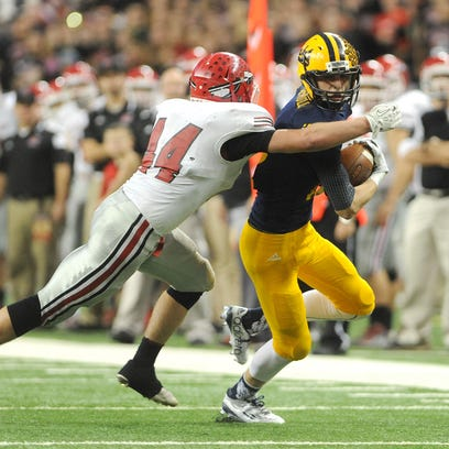 Ithaca wide receiver Spence DeMull (12) breaks to the