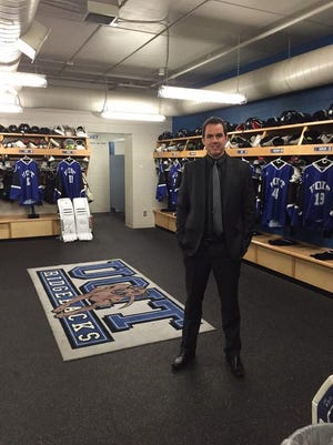 Craig Fisher, in the hockey dressing room of the University of Ontario Institute of Technology.