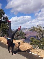 Dolphin moment: Amanda Kingsbury does a cartwheel at