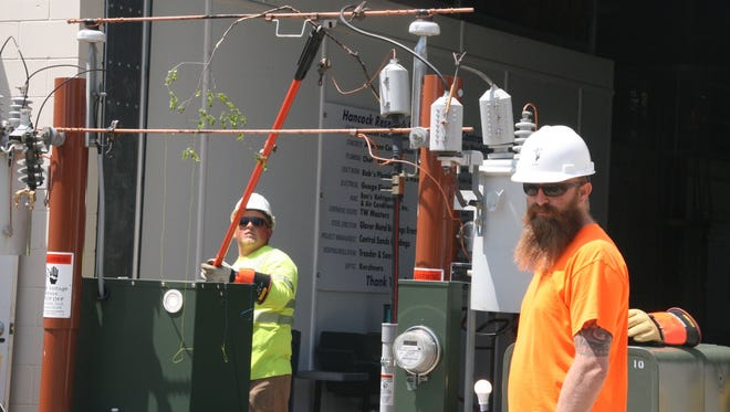 rew members from the Adams-Columbia Electric Co-op demonstrated how they reconnect electric wires following a power outage.