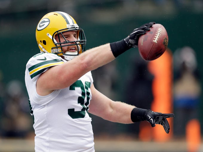 CORRECTS TO 12-YEAR CAREER, NOT 11 - FILE - In this Dec. 20, 2015, file photo, Green Bay Packers fullback John Kuhn celebrates after scoring on a 5-yard run against the Oakland Raiders during the first half of an NFL football game in Oakland, Calif. The Former Packers fullback announced his retirement Wednesday, March 6, 2019, after a 12-year career.  (AP Photo/Ben Margot, File)