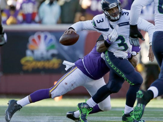 Minnesota Vikings defensive end Everson Griffen (97) tackles as Seattle Seahawks quarterback Russell Wilson (3) tries to throw a pass during the second half of an NFL wild-card football game, Sunday, Jan. 10, 2016, in Minneapolis. (AP Photo/Nam Y. Huh)