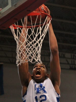 BahamasDana2:  University of Kentucky freshman Karl-Anthony Towns dunks against the Puerto Rico national team at the Big Blue Bahamas tour in Nassau, Bahamas, August 10, 2014. Dana Fritz/Special to the Courier-Journal  (above the fold teaser perhaps  ;-)