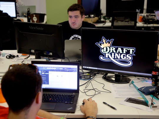 Len Don Diego, marketing manager for content at DraftKings, works at his station at the company's offices in Boston.