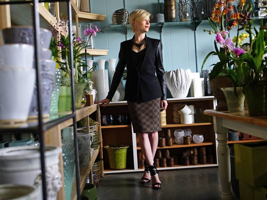 For her work wardrobe, Kathleen Magner-Rios relies on a patterned Burberry skirt, purchased during a trip to New York; J. Crew camisole and necklace; Helmut Lang blazer; Kirna Zabete for Nine West shoes; gold earrings that were a gift from a friend.
