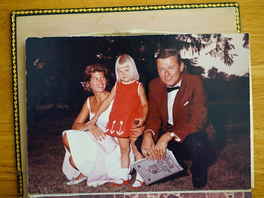 Alfred I. duPont's great-granddaughter, Susanna Dent, is shown with her parents Susan and Alfred DuPont Dent in a family photo. Susanna is pictured at around the age of 4 at her home on Snuff Mill Road where she was raised.