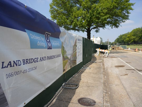 Flintco has started the $33.5 million project to builld a pedestrian bridge over the rail tracks, Walker and Southern that split the University of Memphis campus, as well as a parking garage, amphitheaters and pedestrian mall.
