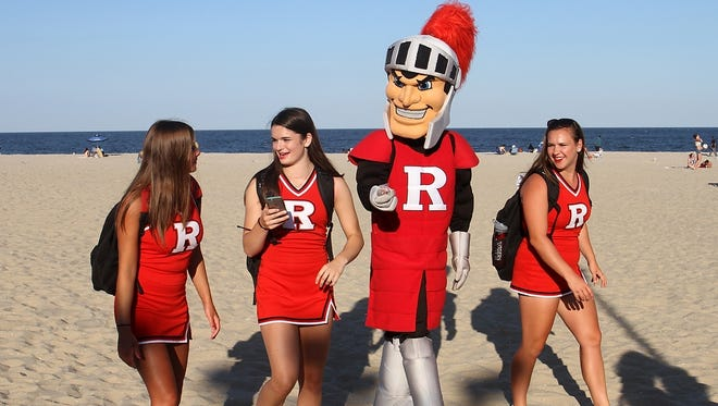 The Rutgers Scarlet Knight walks along the beach with cheerleaders during the Rutgers Shore Tour, Thursday, July 23, 2015, in Point Pleasant Beach, NJ.