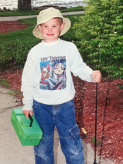 Young Jake Romanack enjoys an early fishing adventure on the shores of Lake Cadillac in Cadillac, Mich.